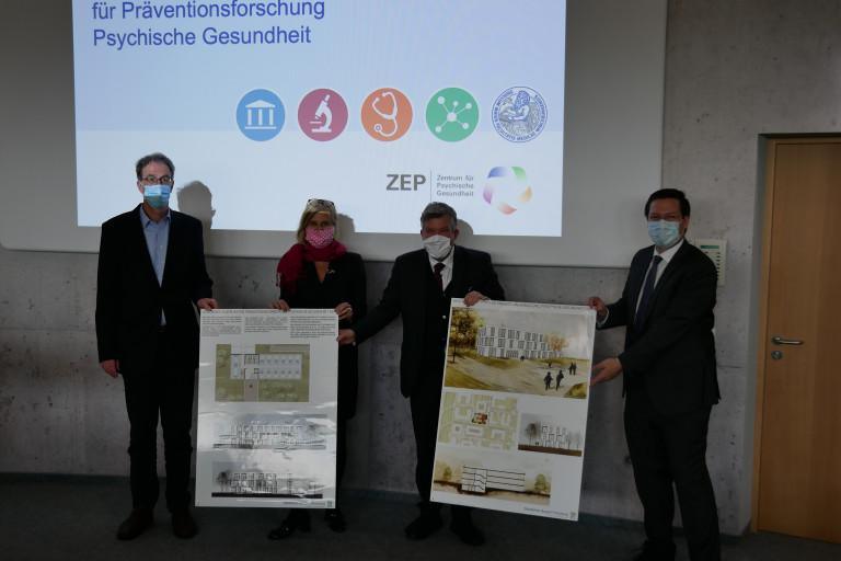 (v.li.) Prof. Dr. Paul Pauli, Simone Strohmayr, Volkmar Halbleib und Prof. Dr. Marcel Romanos